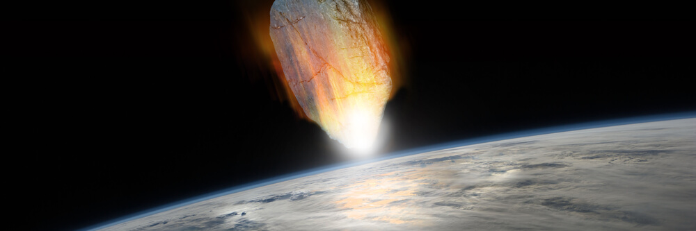asteroid burning through the Earth's atmosphere and about to hit the surface